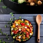 Chickpea salad in black bowl