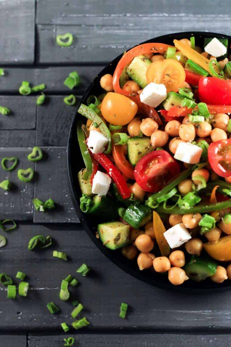 Greek Chickpea Salad - This Greek Salad has a certain balance that comes from this particular combination of vegetables that you just have to try to know for yourself! | ScrambledChefs.com