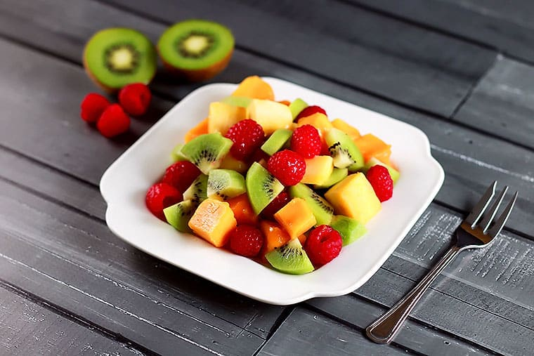 Mango Kiwi Raspberry Salad - Raw, healthy, delicious! Whip this one in under 10 mins - no excuse not to eat healthy! | ScrambledChefs.com