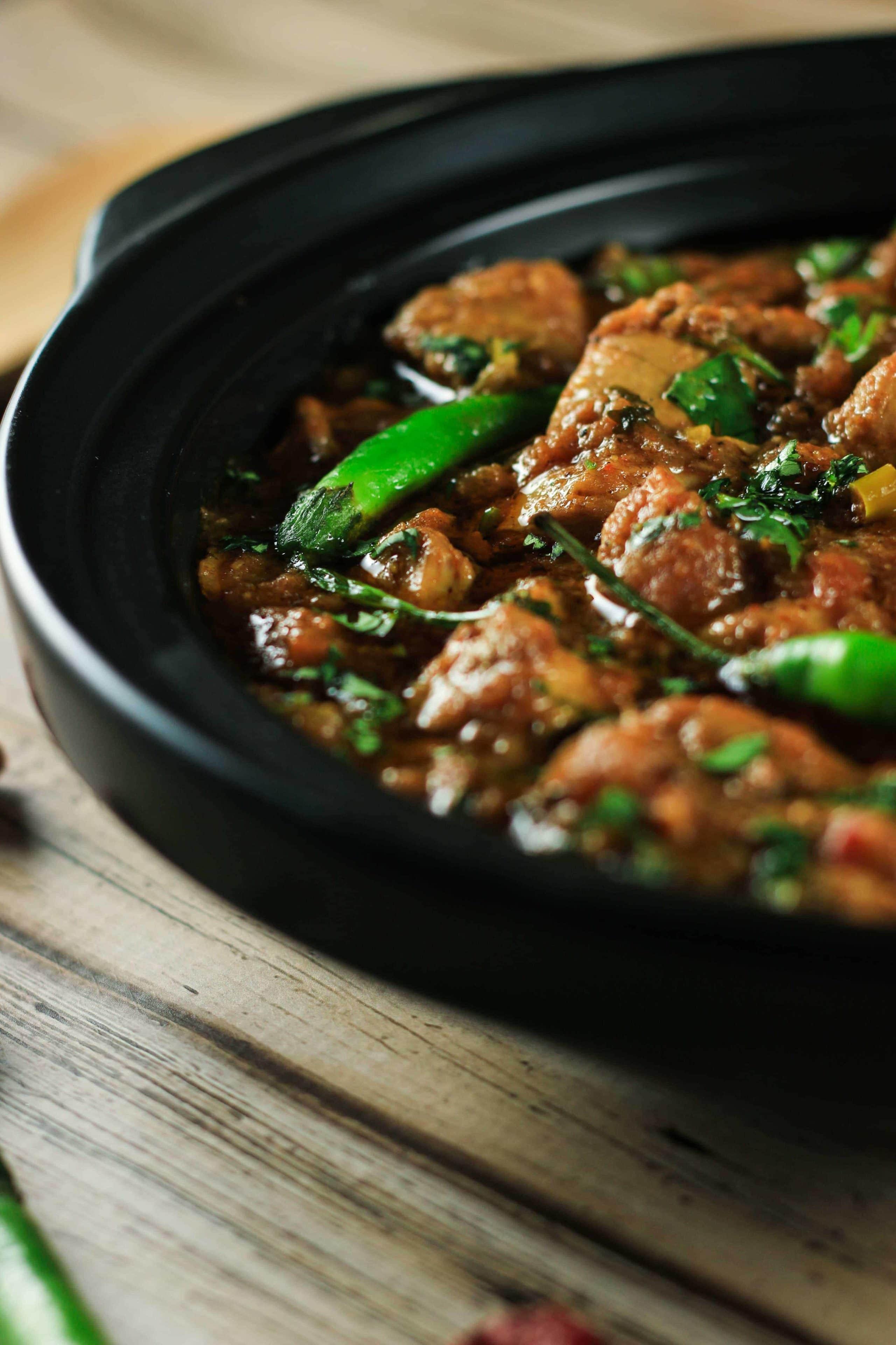 Chicken karahi in black bowl