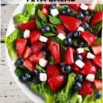 Strawberry blueberry feta salad in white bowl