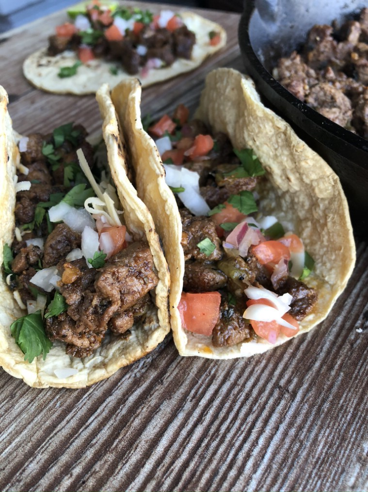 Carne asada tacos with corn tortillas