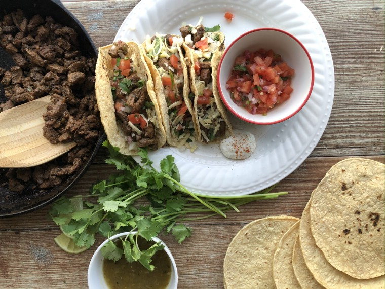 Beef street tacos on a white plate