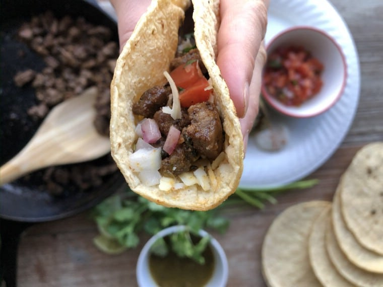 Up close picture of a steak taco on corn trotilla