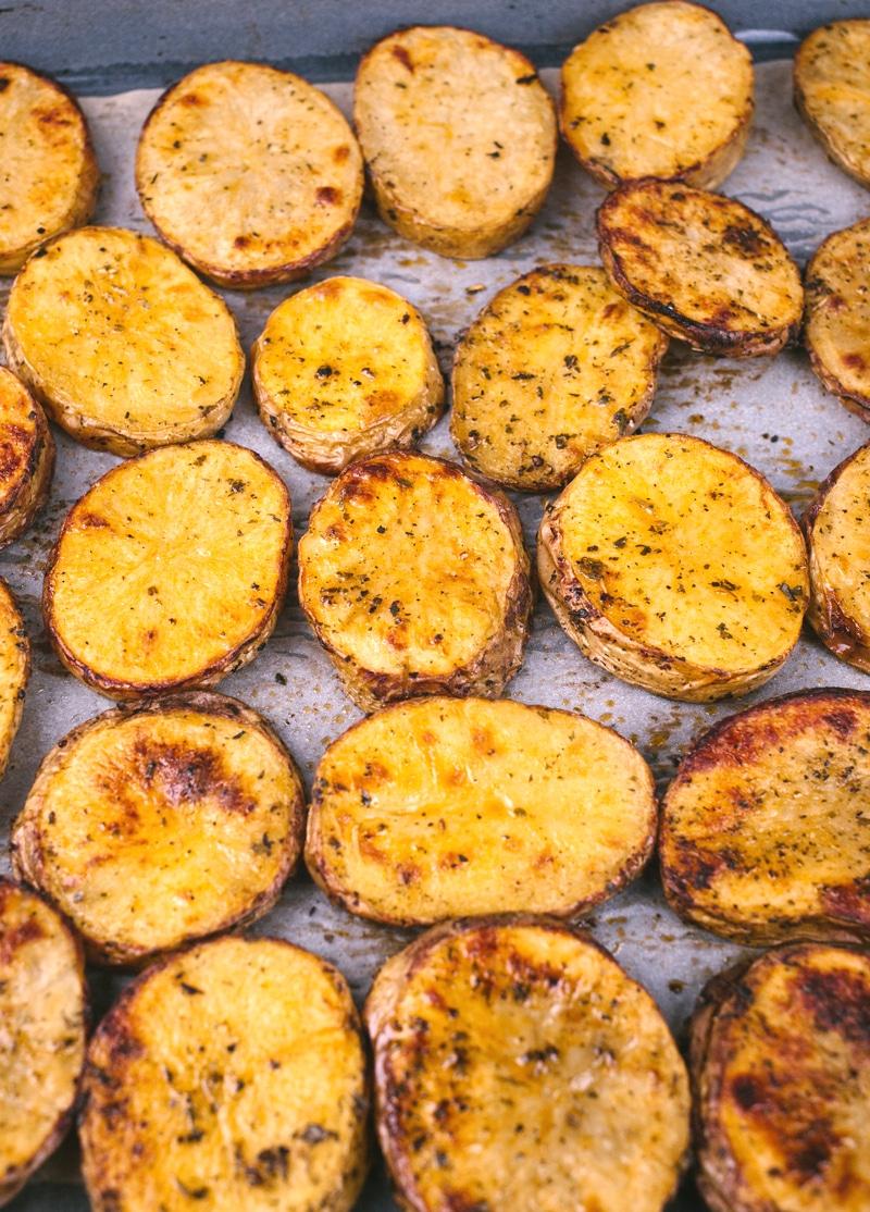 Sliced potatoes roasted on baking sheet