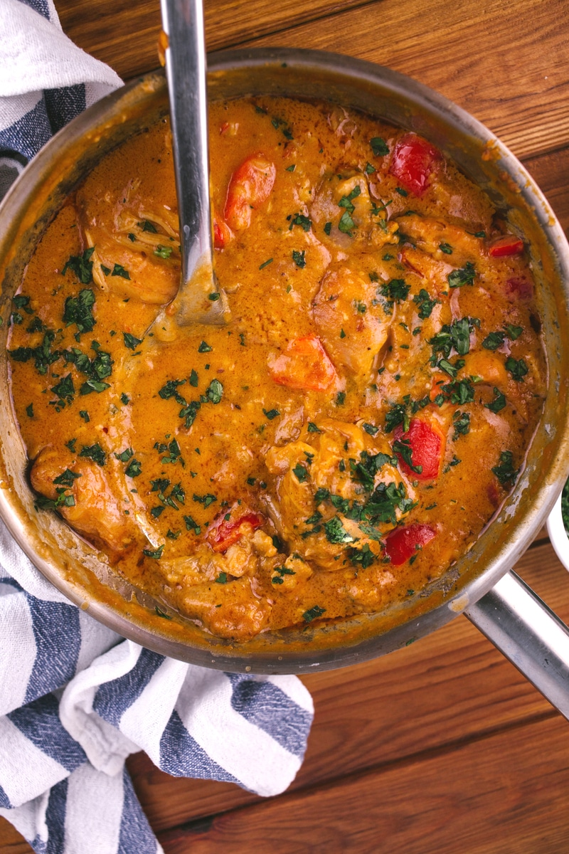 Chicken curry in skillet with peanut sauce