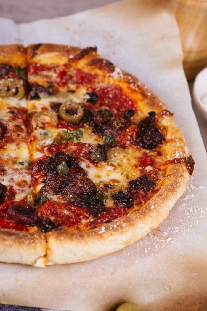 Sicilian style pizza on board