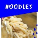 Egg noodles on chopsticks