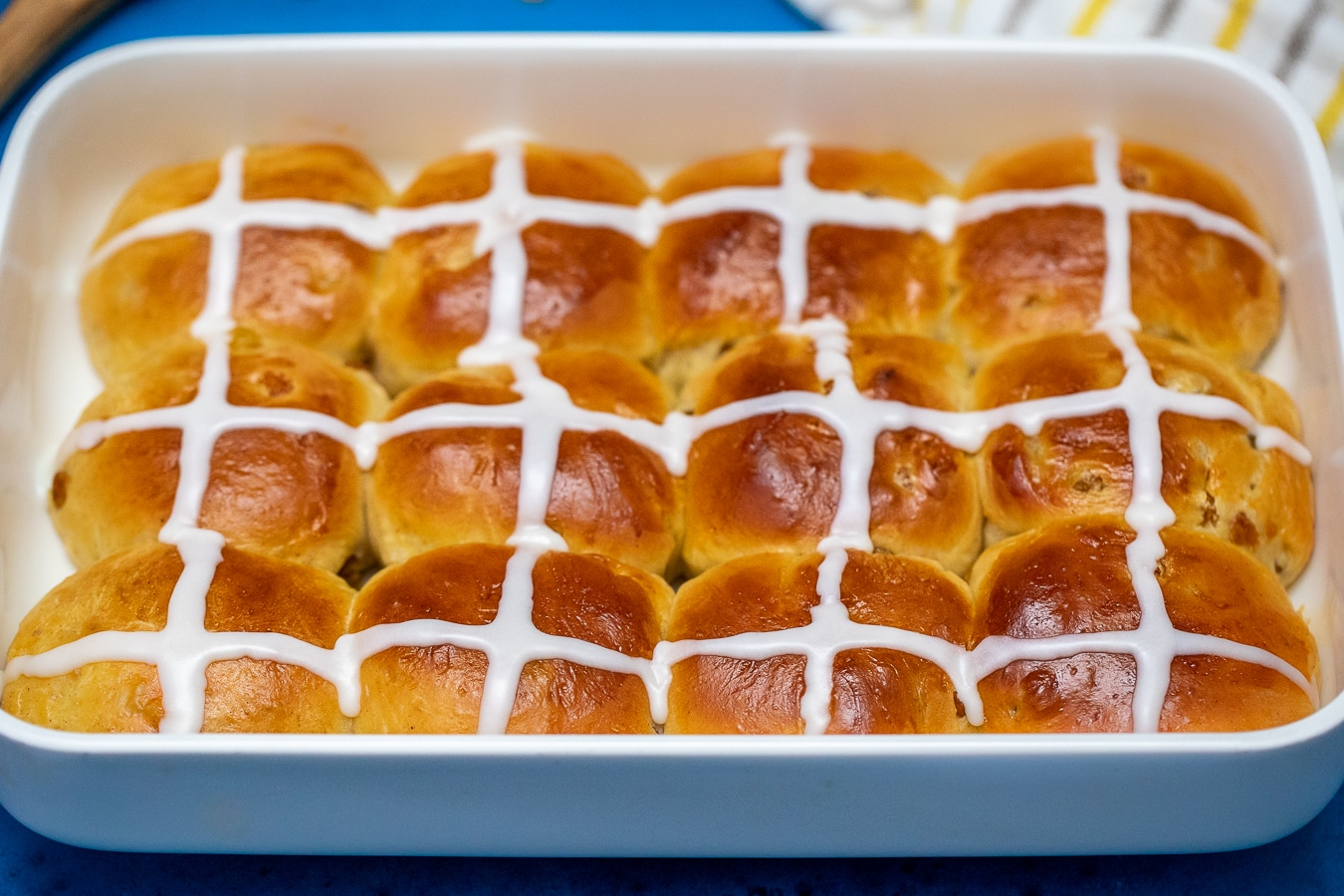 Baking dish filled with hot cross buns