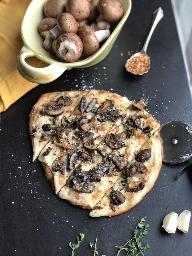 Roasted mushroom and garlic flatbread on table