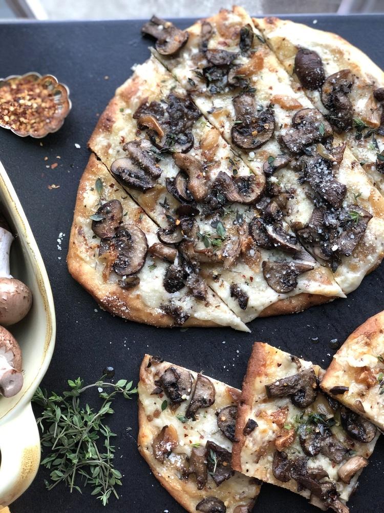Mushroom pizza on black table