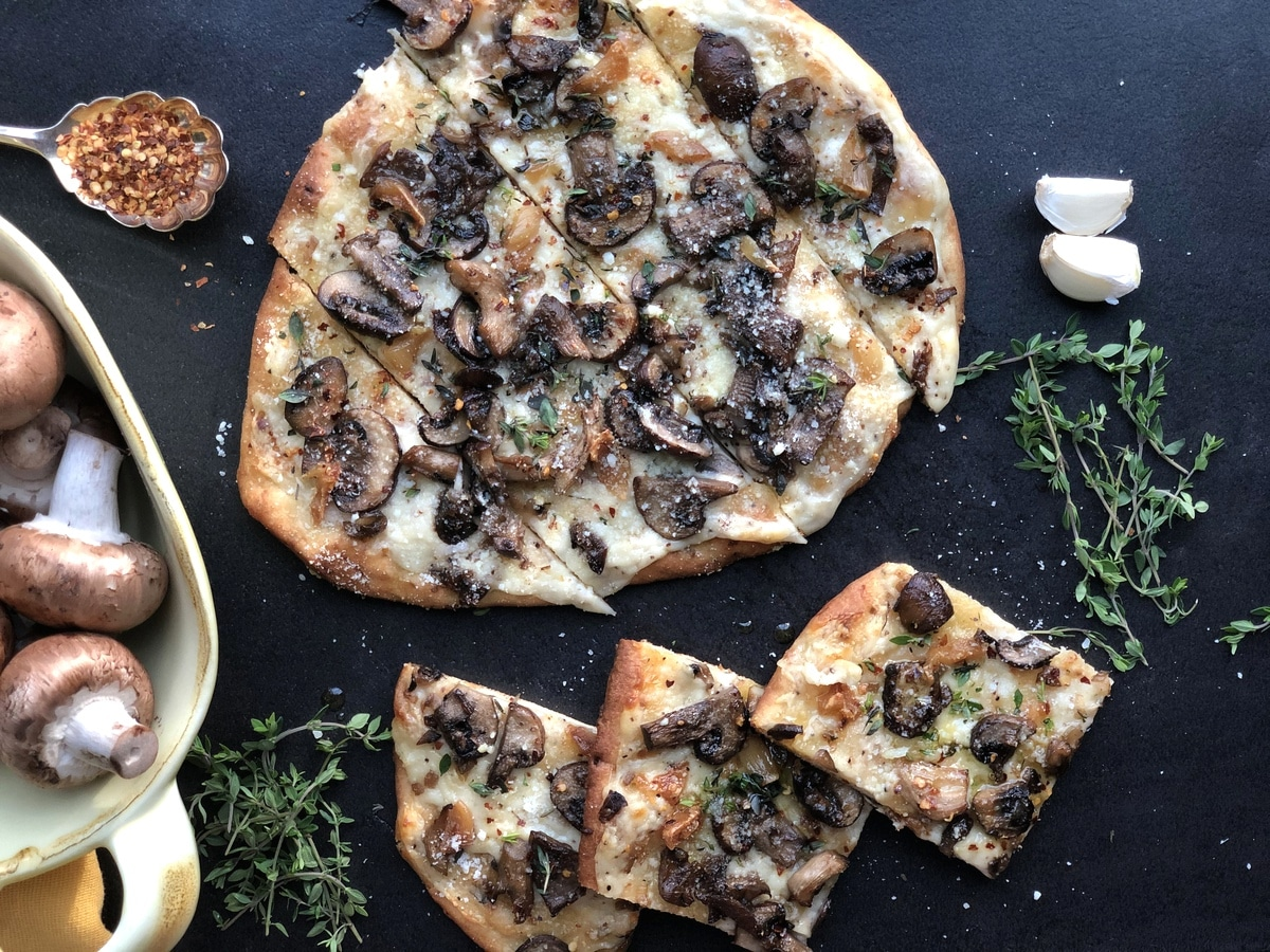 Mushroom flatbread on black surface