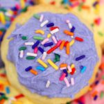 Easter cookie with purple icing and sprinkles