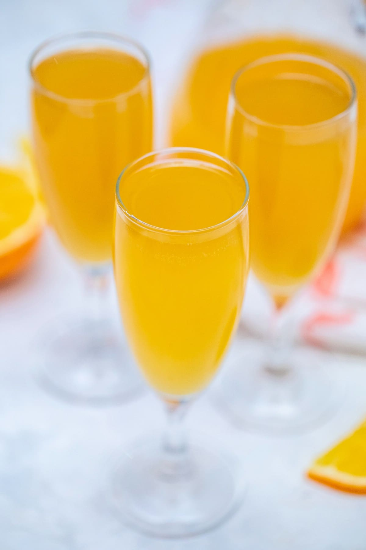 Champagne flutes filled with mimosa