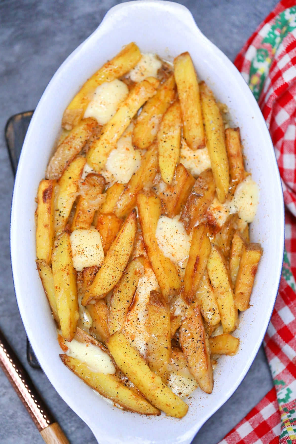 Fries with gravy and cheese on white platter