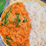 Plate of red lentil curry and rice