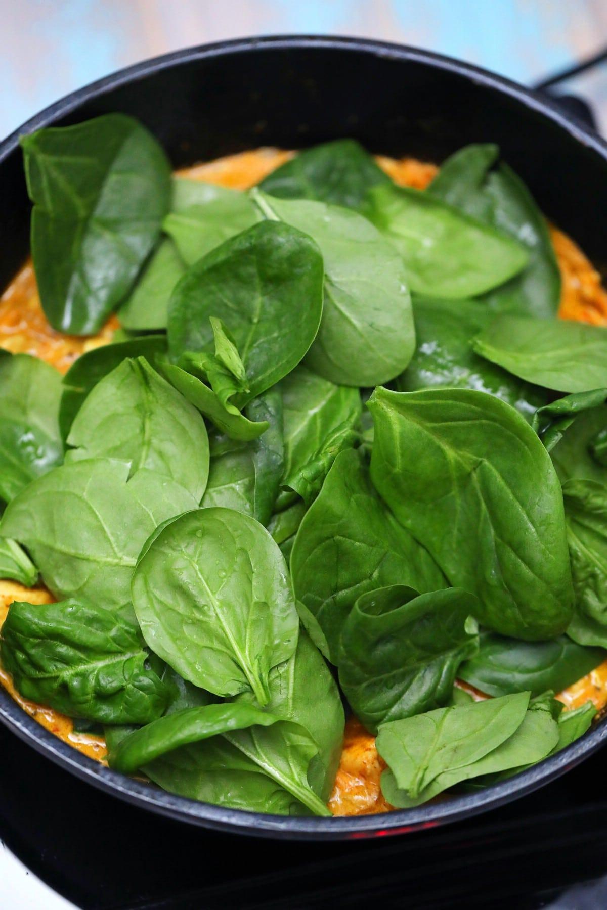 Adding spinach to chicken
