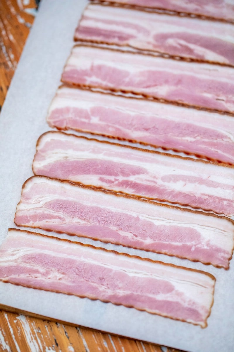 Raw bacon on tray