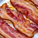 Oven baked bacon on pan