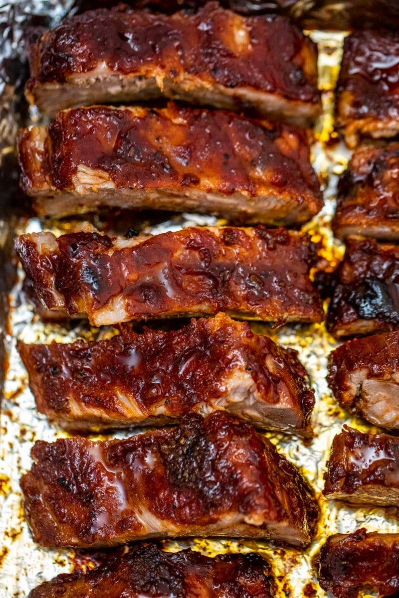 Basted bbq ribs on baking sheet