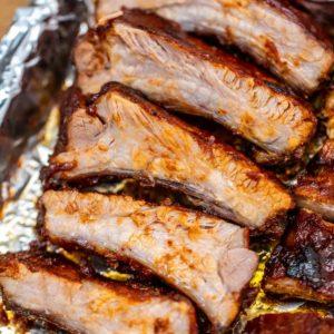 Sliced ribs on baking sheet