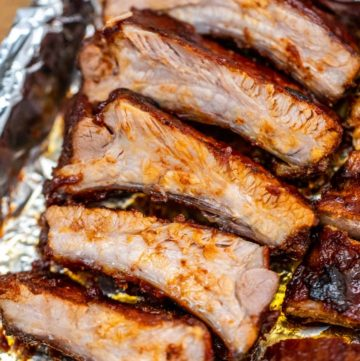 Sliced ribs on baking sheet