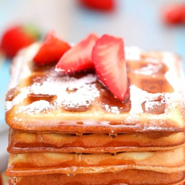 Stack of belgian waffles with strawberries