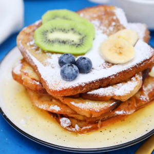 Stack of french toast on yellow plate