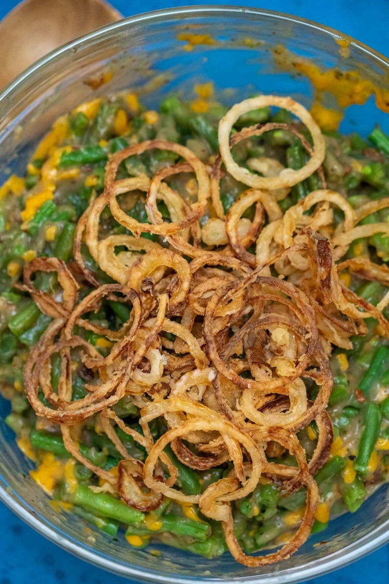 Bowl of green beans with fried onions on top