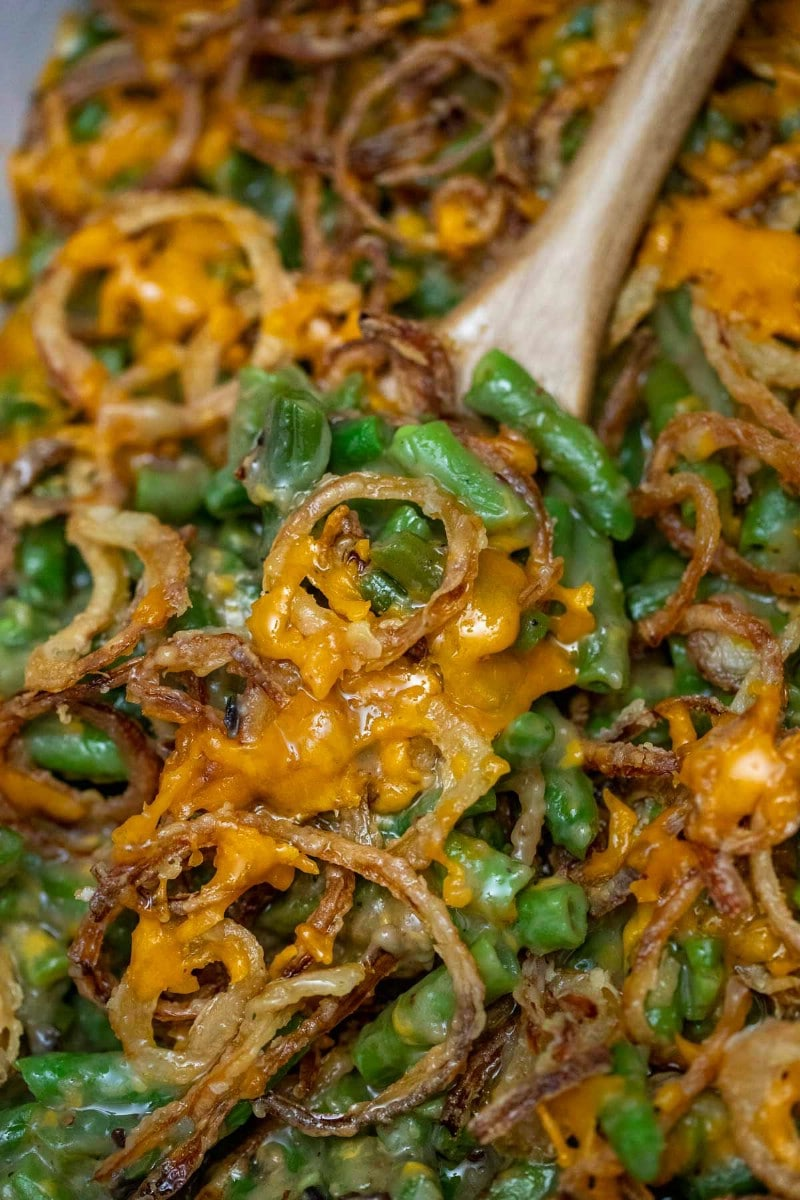 Wooden spoon with green bean casserole