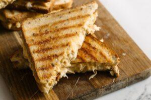 Grilled chicken cheese sandwich cut in half