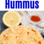 Homemade hummus in whiet bowl with lemon wedge