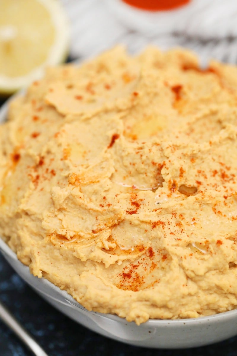 Bowl of hummus with paprika on top