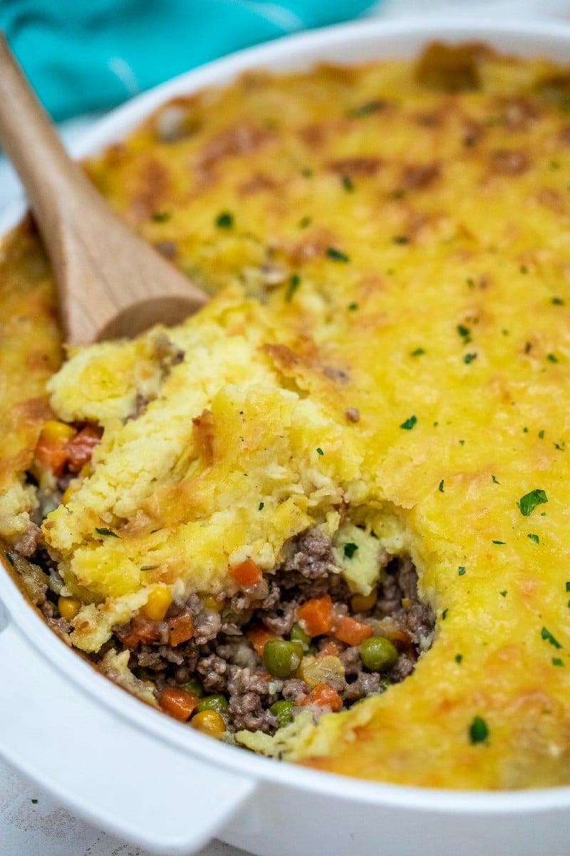 Spoon of shepherd's pie over dish