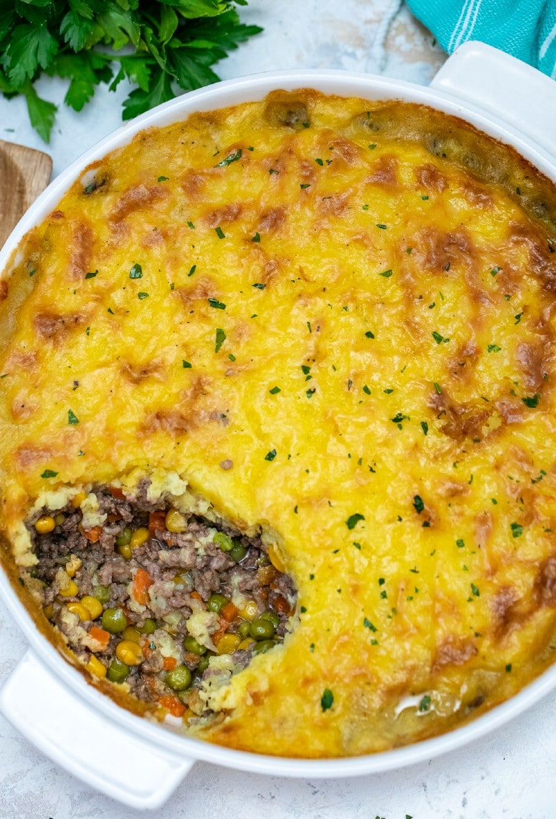 A spoon of shepherd's pie out of dish
