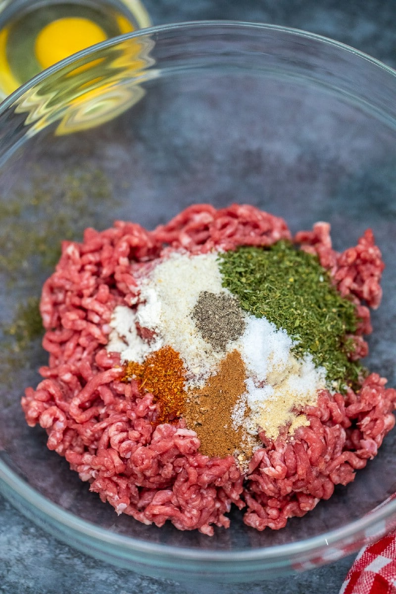Mixing ground beef in bowl