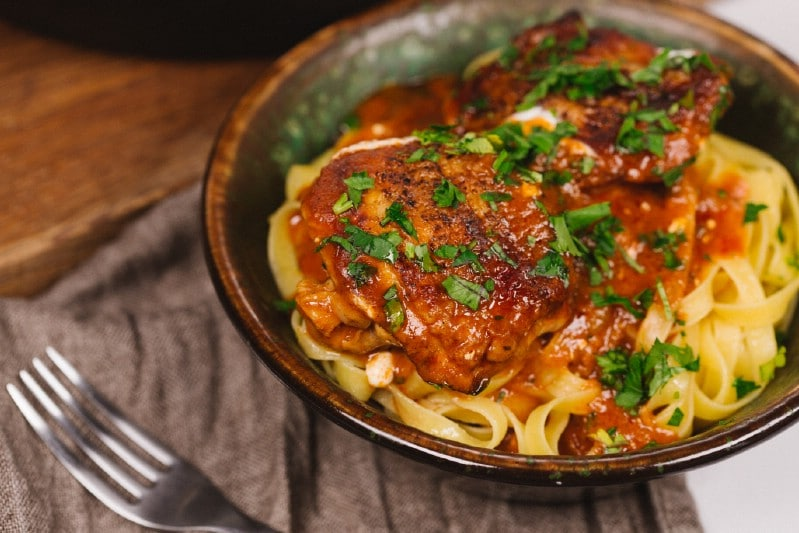 Chicken paprikash over egg noodles