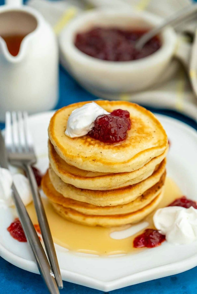 Flapjacks on plate with berry jam