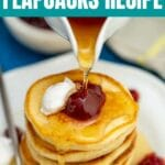 Pouring syrup over stack of flapjacks