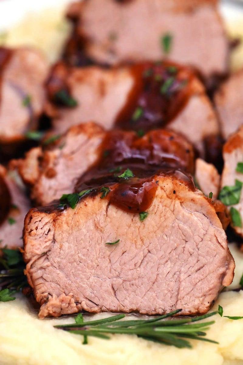 Sliced pork tenderloin with gravy