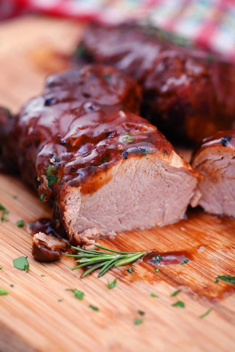 Sliced pork tenderloin on cutting board
