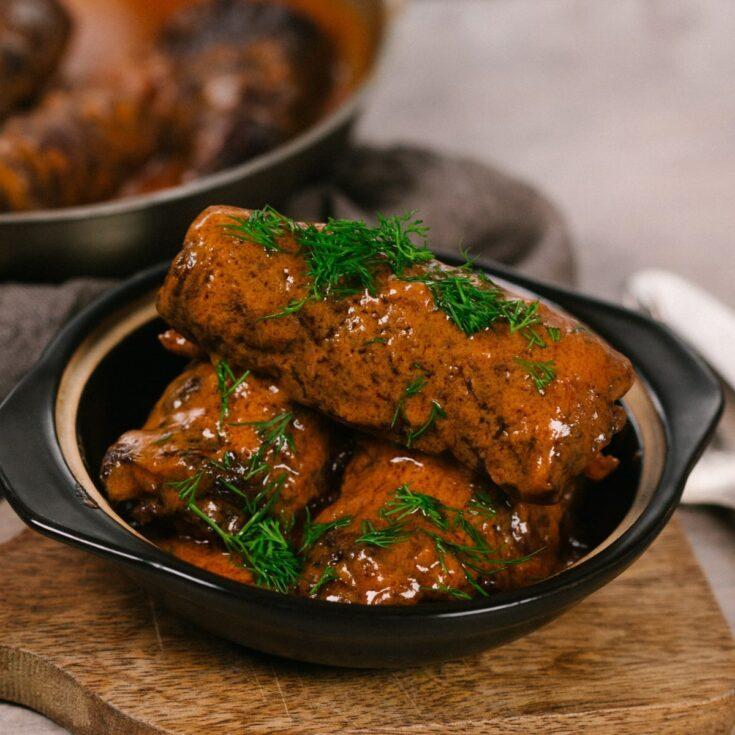 Beef rouladen in black bowl