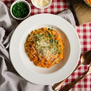 Tomato risotto in white bowl