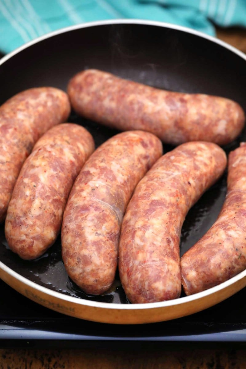 Cooking pork sausages in skillet