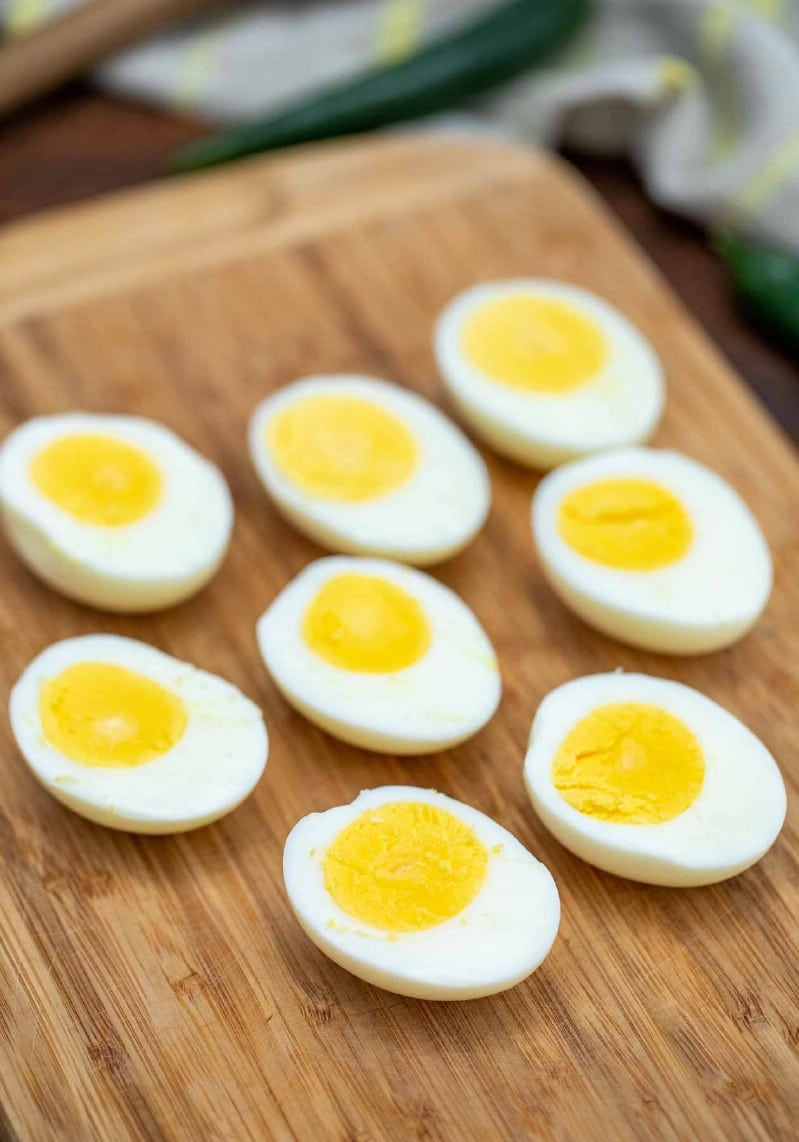 Sliced hard boiled eggs on cutting board
