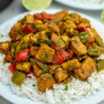 Jamaican chicken curry on plate with rice