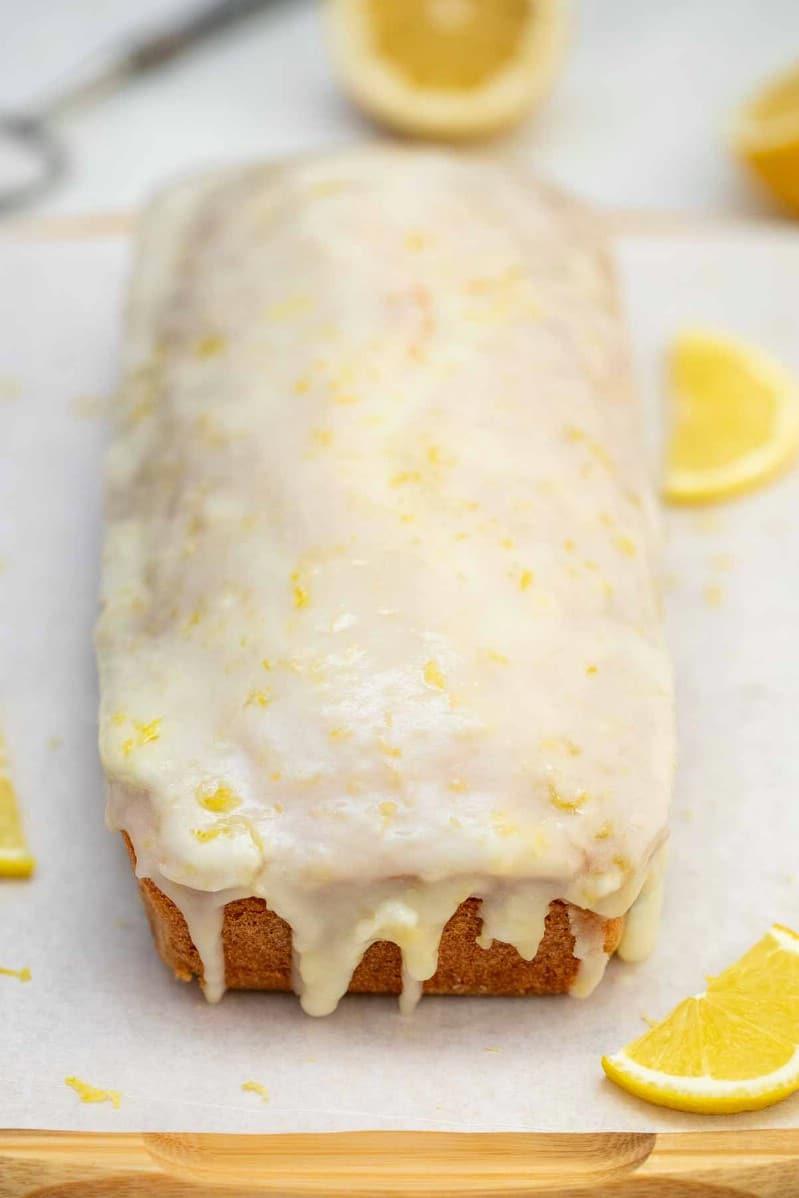Lemon cake loaf on plate with glaze