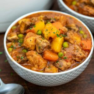 Pork stew in white bowl