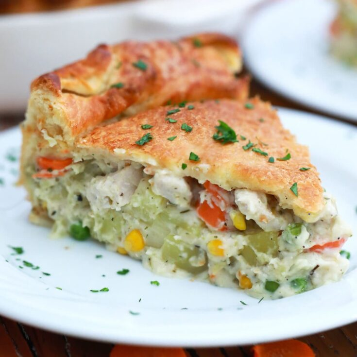 Chicken pot pie slice on white plate