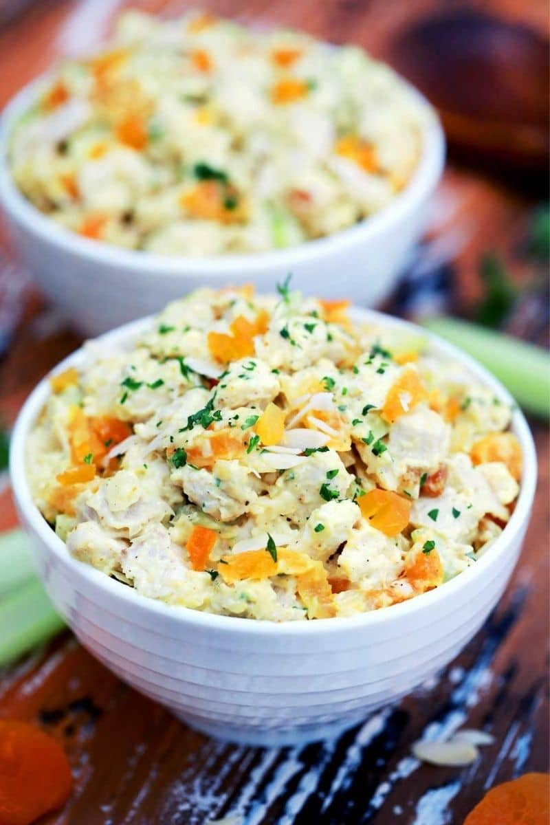 White bowls of coronation chicken salad
